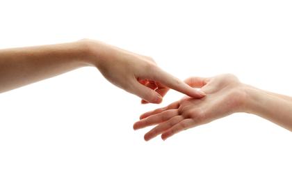 手のひらを指す指